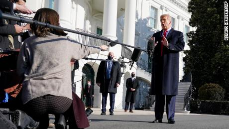 President Donald Trump talks to the media before boarding Marine One on the South Lawn of the White House, Tuesday, Jan. 12, 2021 in Washington, DC.